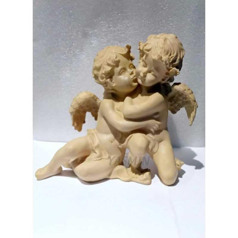 angeles-pareja-sentada.jpg
